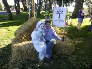 Easter Bunny sitting on hay bales with volunteer