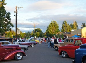 cars lined up on street for cruise in